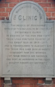 The engraved stone is placed on the front of the old clinic in Denmark Street